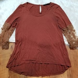 Doe & Rae burgundy blouse with tan lace at sleeves